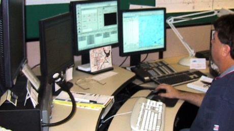 Police dispatcher training at a computer aided training station.